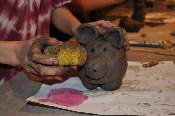 Learning to sculpt in clay at Wychwood.